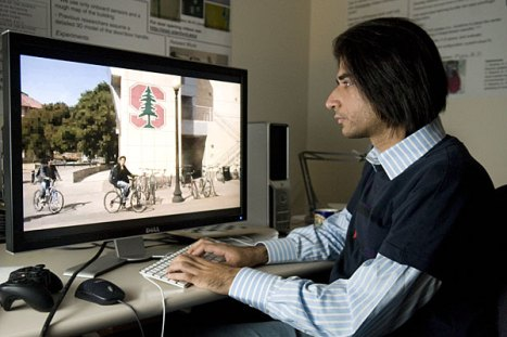 Siddharth Batra, graduate student in computer science, places the Stanford logo onto a wall of the Hewlett Teaching Center using software that can embed graphics into a video—images, photos or even another video.